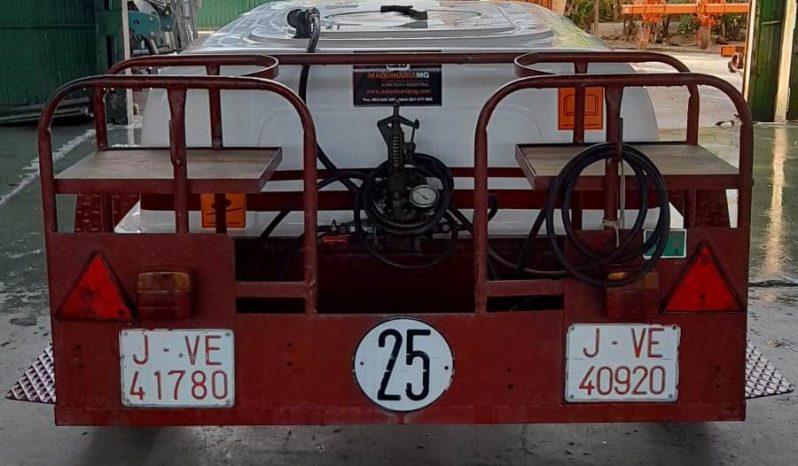 Cuba arrastrada 1500 litros con bomba Abella lleno